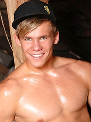 Blonde jock showing his naked and oiled body