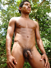 Young latino boy Juanito jerking in the jungle